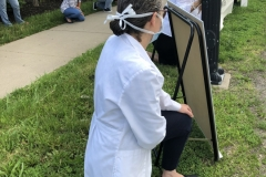 Jordan Health White Coats and staff  take a knee for Black Lives Matter Movement